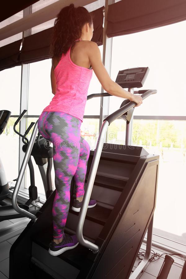 Sporty young woman training legs. In gym royalty free stock photography
