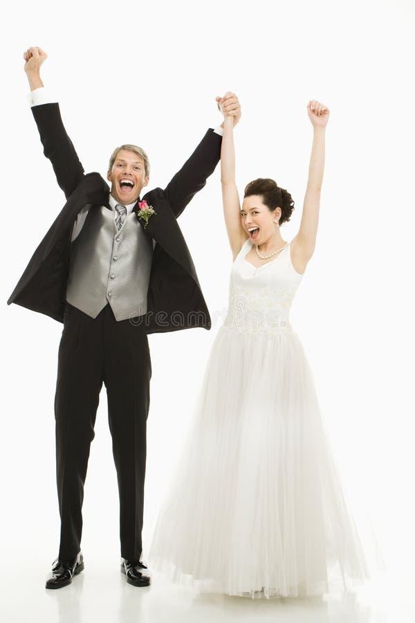 Sposa e sposo incoraggianti. fotografia stock