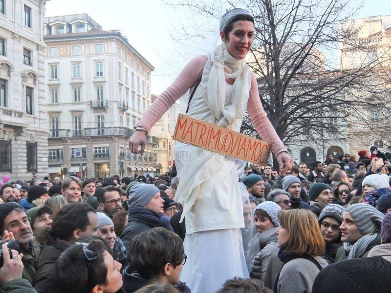 Sposa su trampoli Sveglia Italia. Milano, piazza della scala, 23 gennaio 2016, manifestazione 'Sveglia Italia' pro Unioni Civili royalty free stock photography