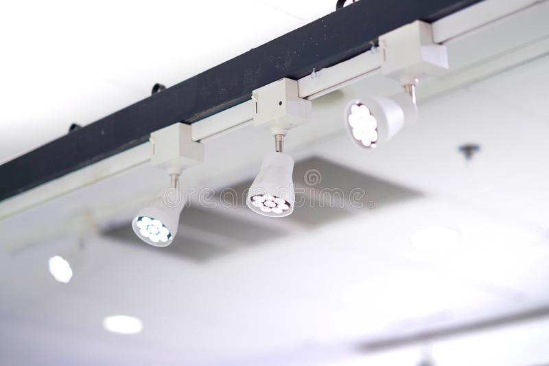 Spot light lamps installed on high bar royalty free stock photos