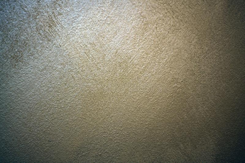 A spot of light on a textured pearl plaster. stock image
