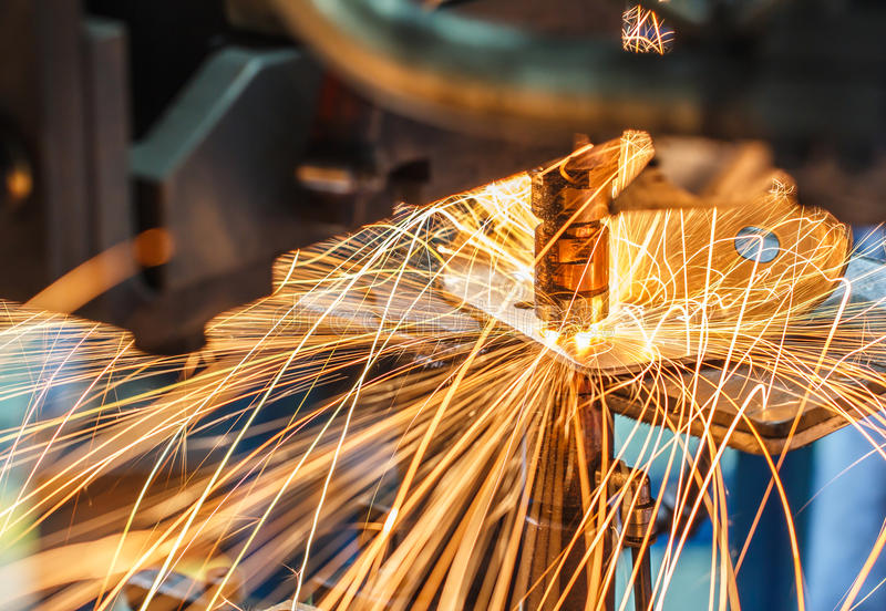Spot welding machine, automotive part in a car factory. Industrial, automotive spot welding, in a car factory with sparks, manufacturing, industry royalty free stock images