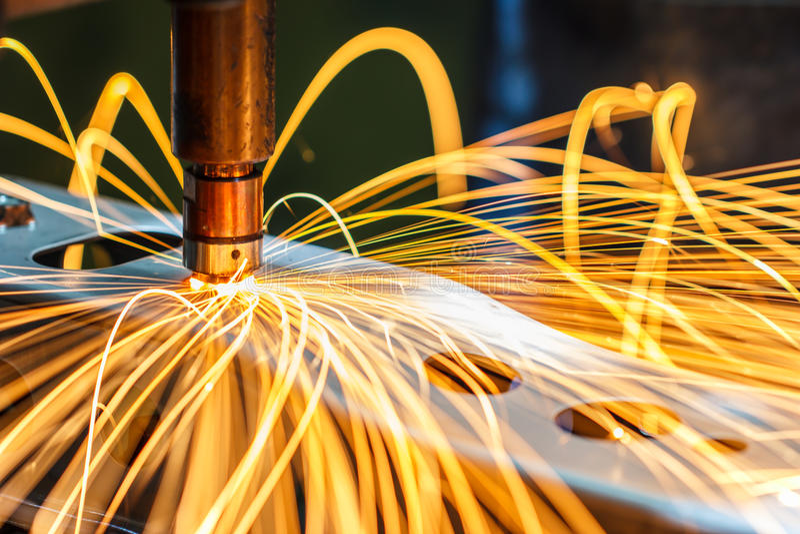 Spot welding machine, automotive part in a car factory. Industrial, automotive spot welding, in a car factory with sparks, manufacturing, industry stock image