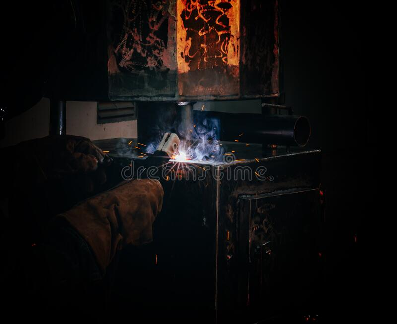 Spot welding of a metal product in locksmith workshop. Spot welding of a metal product in a locksmith workshop royalty free stock photo