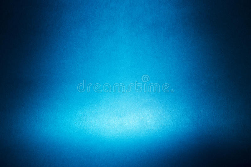 Spotlight on a blue wall. Abstract background stock image
