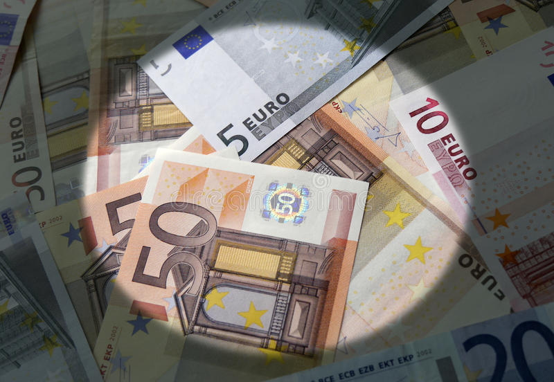 Spotlight on the Euro currency. Spotlight effect applied to mixed value Euro currency bank notes stock photography