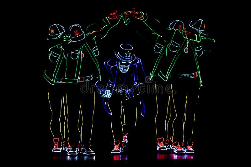 Bucharest Spotlight Festival dancing crew with lights royalty free stock image