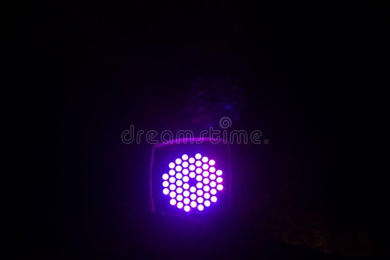 Spotlight. Indigo color electric light stage floral Glowing, salt, bricks, background, interior, mine, tower, made, tiles, khewra, saltmines, pakistan, table royalty free stock photos
