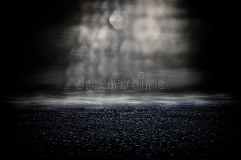 Spotlight over concrete floor. dark black background. Grunge fog product backdrop mist road abstract asphalt blur blurred blurry boke bokeh cement disco display stock photography