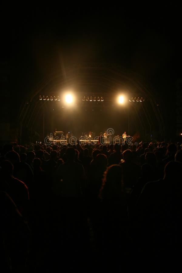 Spotlight over Crowd in concert stock image