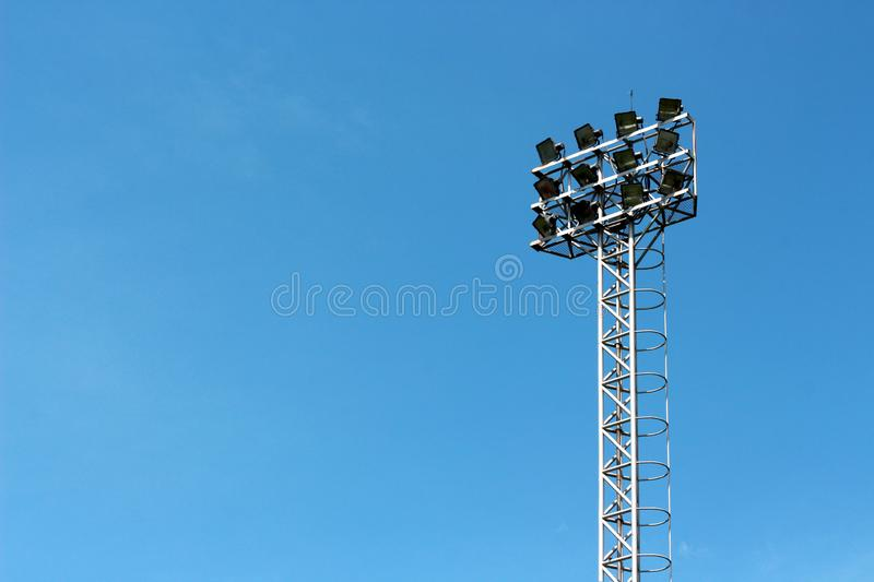 Spotlight Standing Tall on Blue Sky Background. Spotlight Stadium Standing Tall on Blue Sky Background stock photo