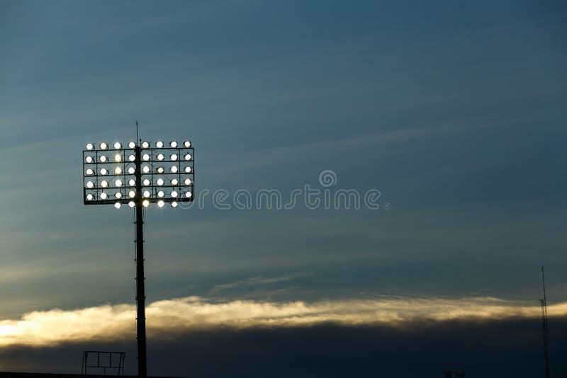 Spotlight under blue sky. stock photos