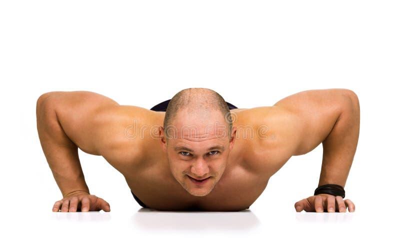 Spotsman que faz push-ups imagem de stock