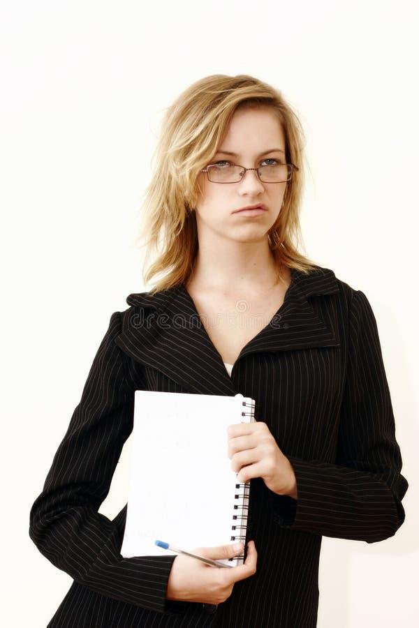 Spottende Geschäftsfrau stockfoto