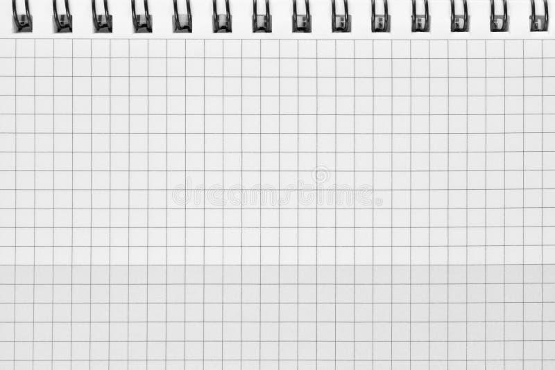 Sprawdzać ślimakowatego notatnika tła wzór, horyzontalna chequered ciosowa otwarta notepad kopii przestrzeń, stapled pustego miej zdjęcia royalty free
