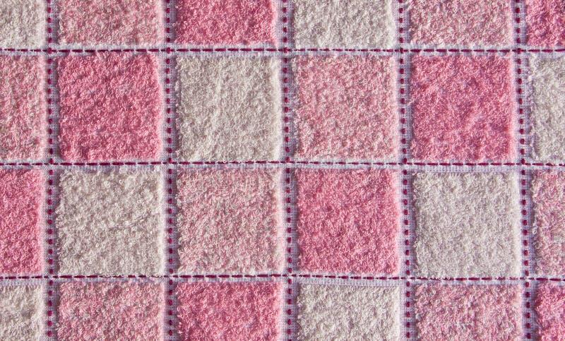 sprawdzać różowy ręcznikowy biel zdjęcie royalty free