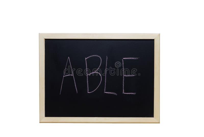 SPRAWNIE pisać z biel kredą na blackboard obraz stock