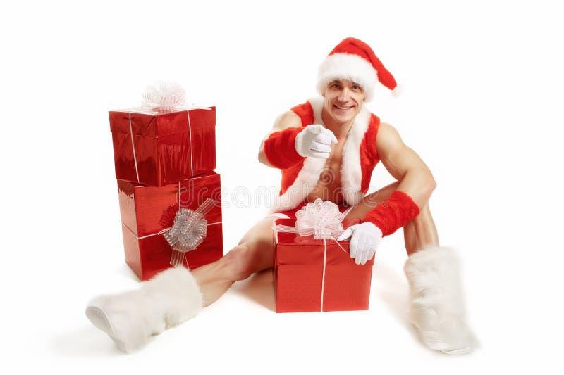 Sprawność fizyczna Święty Mikołaj wskazuje jej palec zdjęcia stock