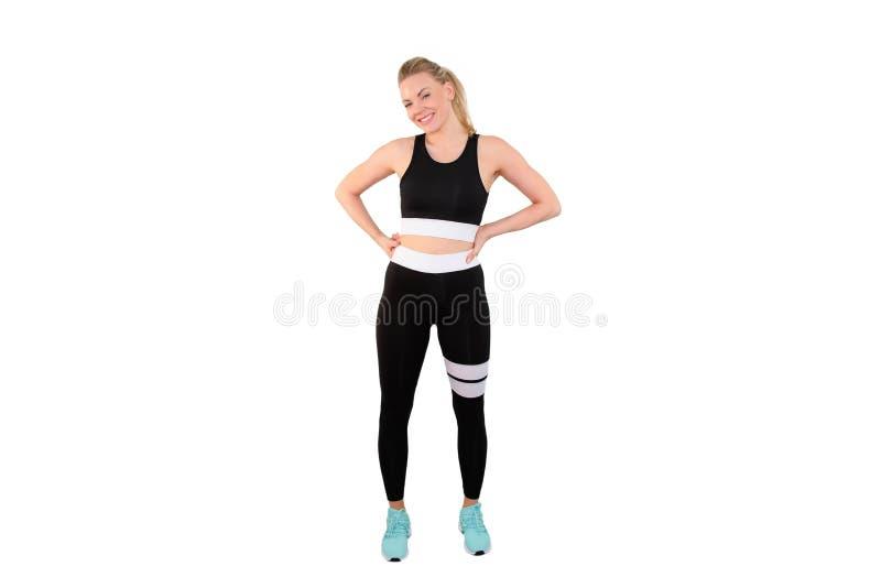 Sprawność fizyczna model w sportswear pozuje na bielu plecy gruntuje - wizerunek obraz royalty free