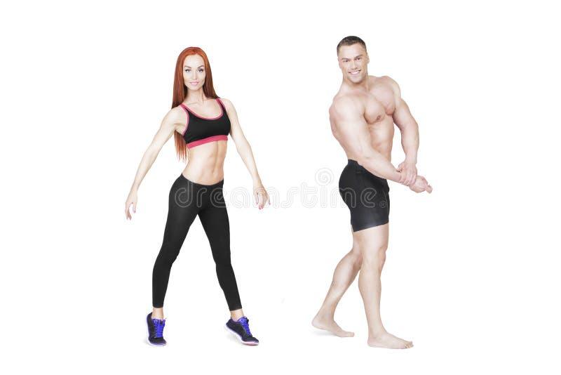 Sprawność fizyczna trenery mężczyzna i kobieta Pozuje na bielu zdjęcia stock