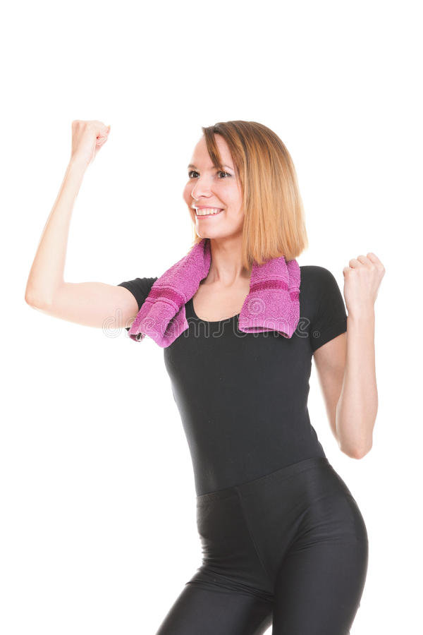 Sprawności fizycznej kobieta skacze excited odosobnionego żeńskiego ono uśmiecha się pokazuje mu obraz royalty free
