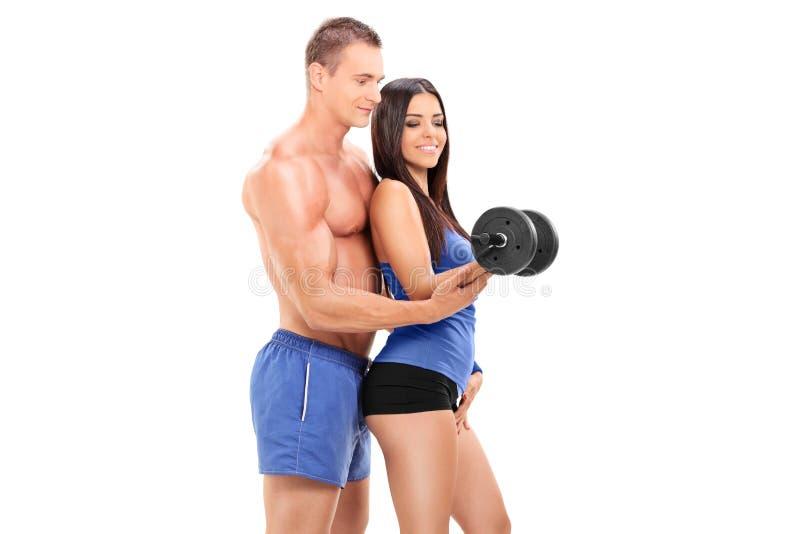 Sprawności fizycznej powozowy ćwiczyć z żeńską atletą obrazy stock