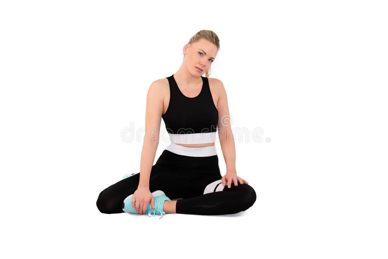 Sprawno?ci fizycznej kobieta w sportswear w studiu na bielu plecy gruntuje - wizerunek obrazy royalty free