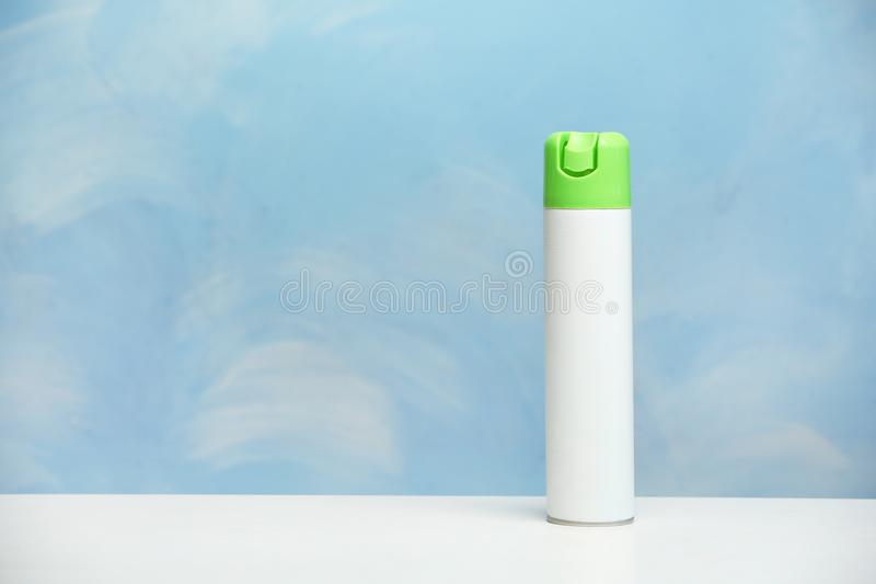 Spray air freshener on table royalty free stock image