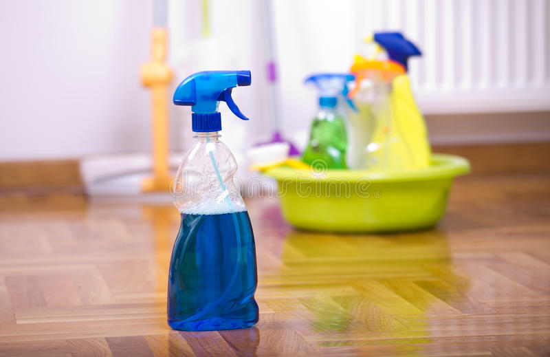 Spray bottle for cleaning on the floor stock image