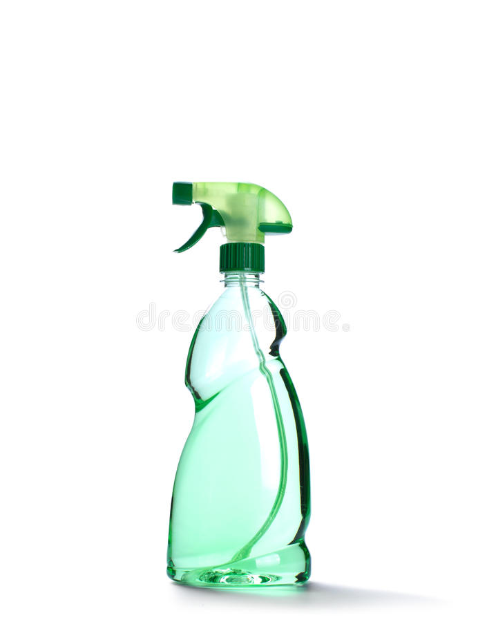 Spray bottle with green liquid. Isolated on white royalty free stock photography