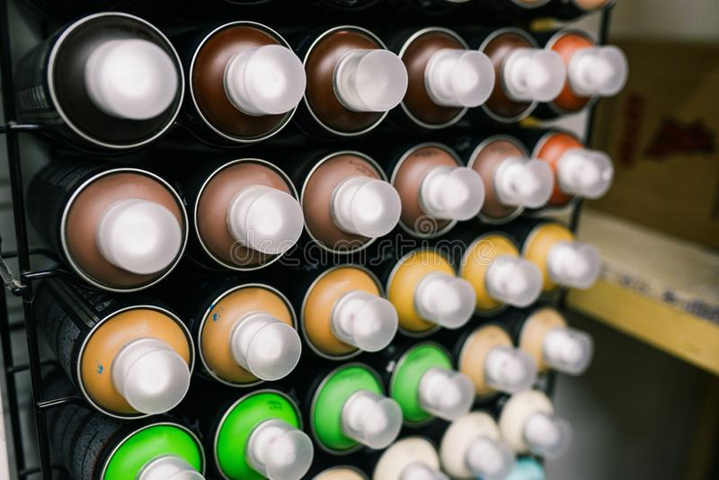 Spray cans. New cans of paint for graffiti or drawing. Paint sales in the store. Creativity and art stock photography