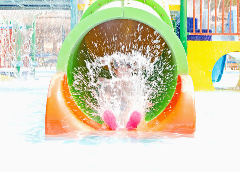 The spray from the child in the water Park stock photo