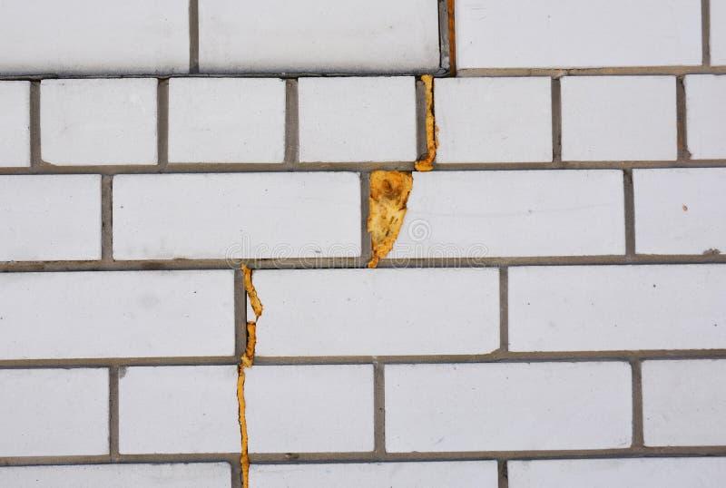 Spray Foam Insulation. Insulate wall cracks with foam caulking gun. House Wall crack with Foam Insulation Gun royalty free stock photo