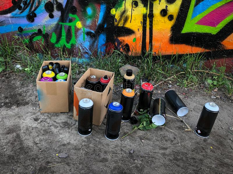 Spray paint cans for graffiti on floor stock photo