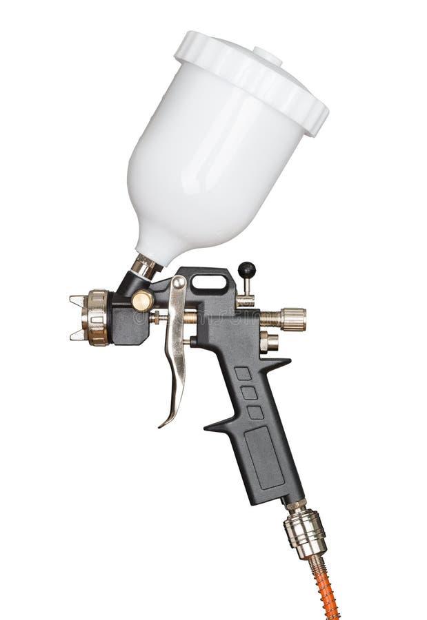 Spray paint gun. Isolated on white stock photography