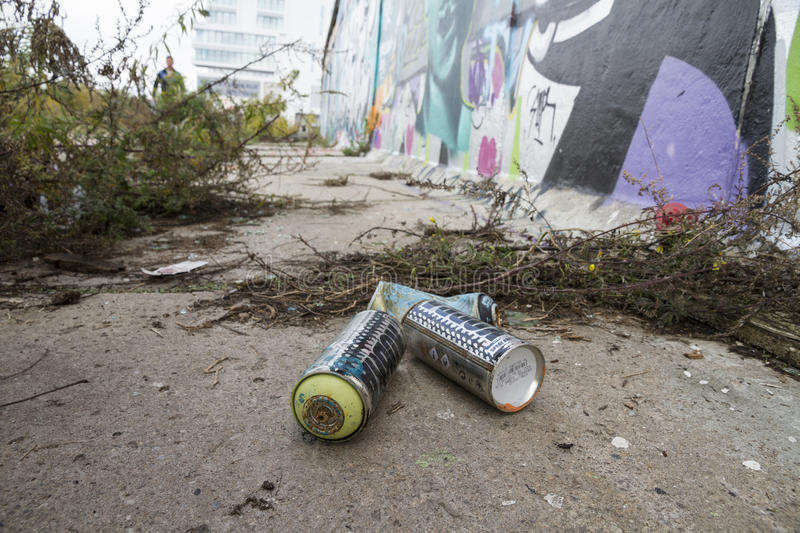 Download Spray Paint Lying On The Pavement Infront Of The Berlin Wall Editorial Photo - Image: 83704831