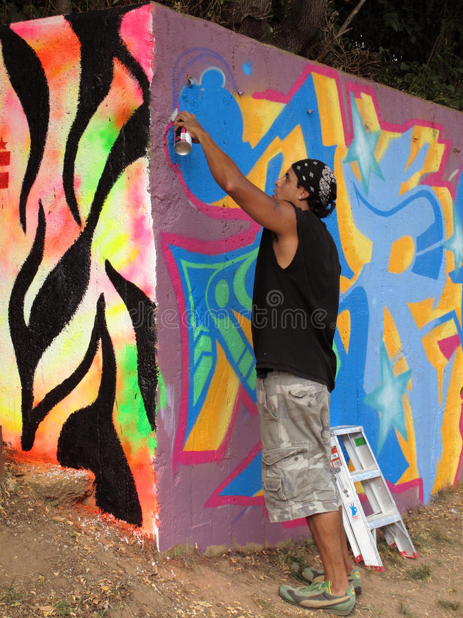 Download Spray Painting the Wall editorial photography. Image of painting - 10566632