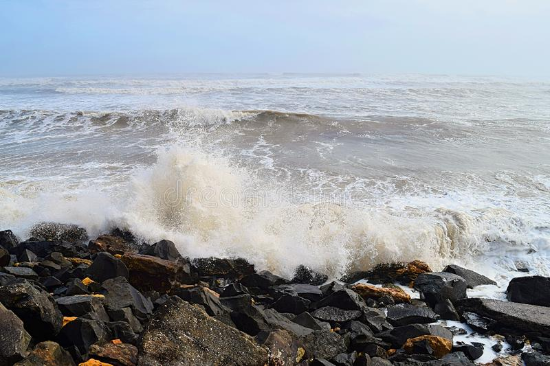 Spray of Water Drops with Hitting of Sea Wave to Rocks on Shore - Ocean Natural Aqua Background royalty-vrije stock afbeeldingen
