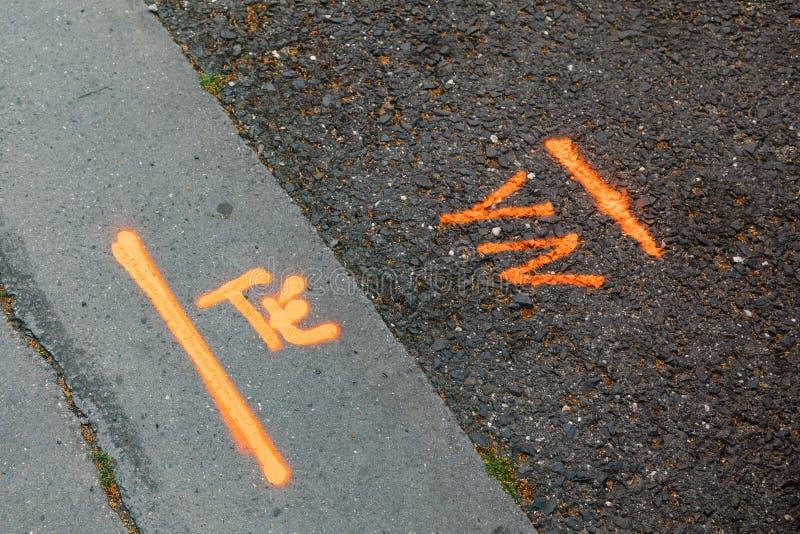 Sprayed asphalt marks sign arrow construction royalty free stock photos