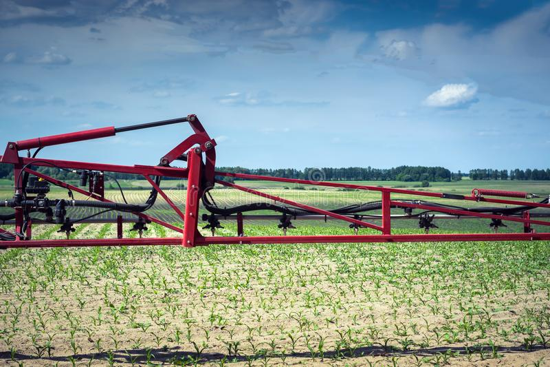 The sprayer bar before going out into the field to apply a herbicide, in order to protect young corn from the competition of weeds stock photography