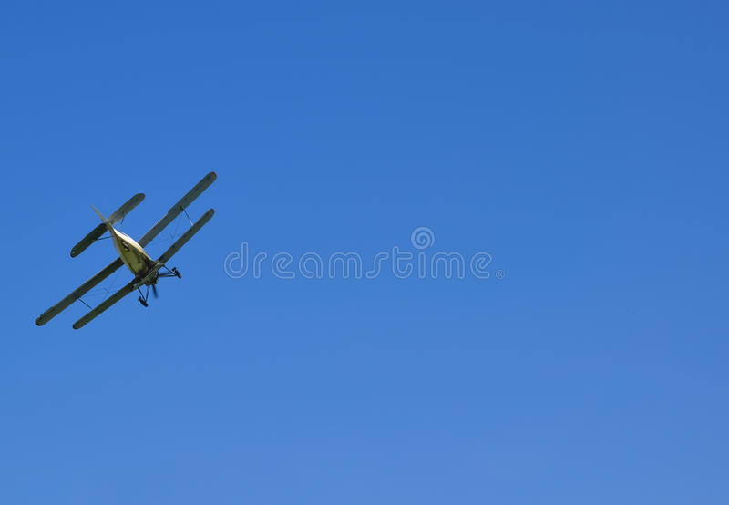 The spraying of fertilizers and pesticides on the field with the aircraft. Aircraft agricultural aviation AN-2. The spraying of fertilizers and pesticides on stock images