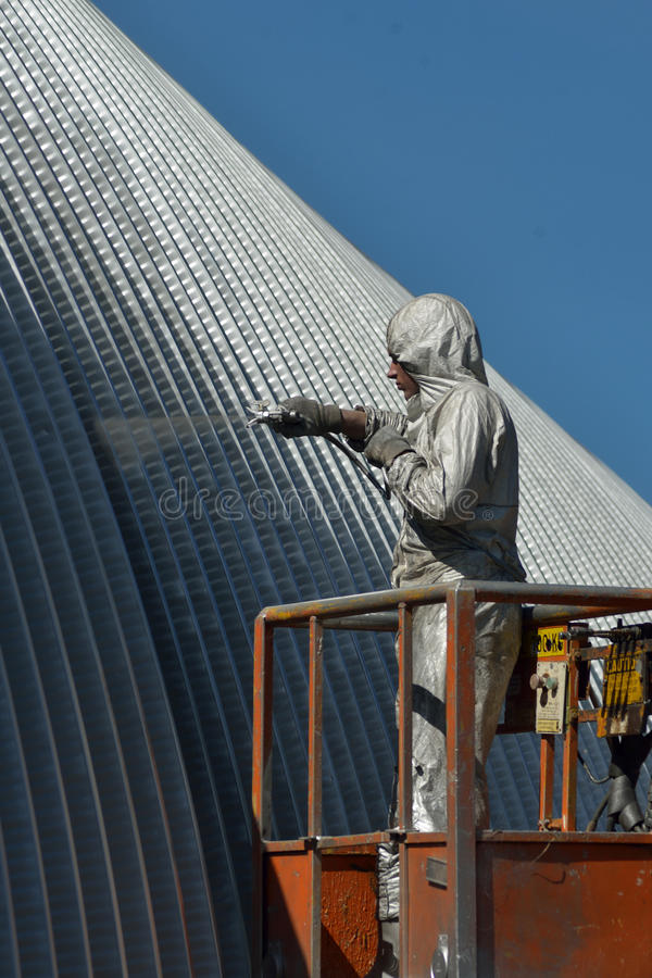 Spraying the roof royalty free stock image