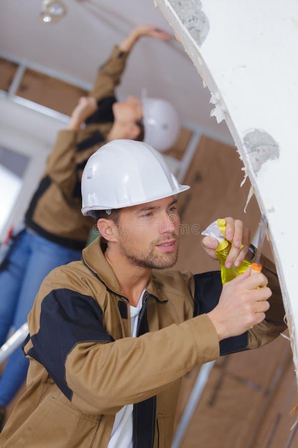 Spraying wallpaper for easy scraping stock photos