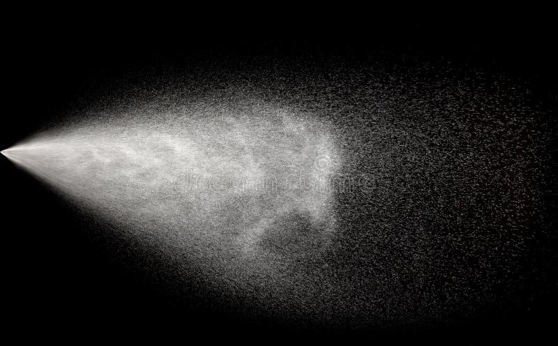 Spraying water in motion stock photo