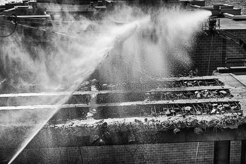 Spraying Water Over the Alaska Way Viaduct. SEATTLE, USA - MARCH 2, 2019: Construction workers spray water over the remains of the Alaska Way Viaduct in Seattle royalty free stock images