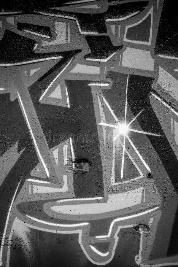 Spraypaint, a city wall with graffiti in black and white, urban. Art stock photos