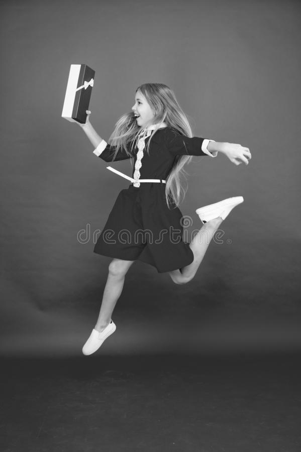 Spread happiness and joy. Little child in motion jump. Delivery christmas present. Gifts delivery. Delivery service royalty free stock image