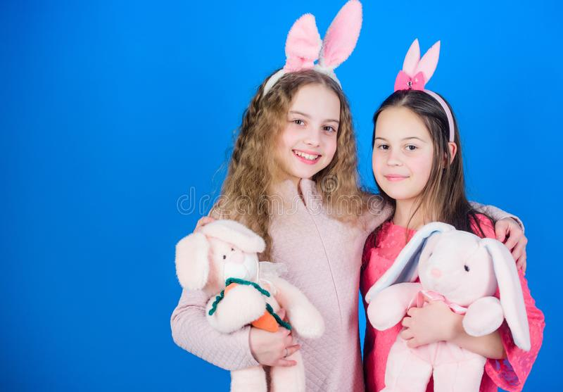 Spread joy and happiness around. Hope love and joyful living. Friends little girls with bunny ears celebrate Easter royalty free stock photo