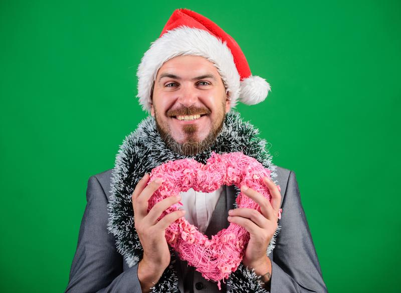 Spread love around. Man in love happy wear santa hat celebrate christmas green background. Merry christmas and happy new royalty free stock images