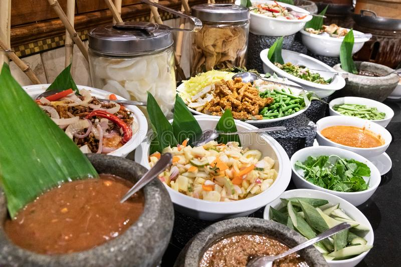 Ulam, traditional Malay food of raw vegetable with chili dipping. Spread of Ulam, traditional Malay food of raw vegetable with chili dipping royalty free stock images